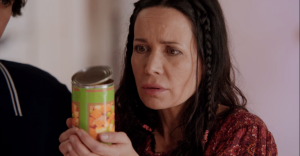 Janeane Garofalo as Beth, with the can of vegetables as the can of vegetables.