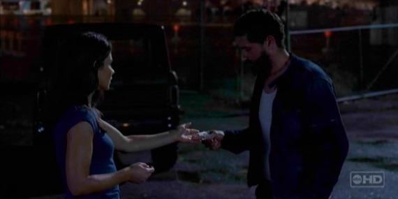 A bearded Jack holds onto Kate's hand in a darkened lot