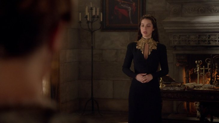 Mary in a velvet black dress with a keyhole neckline.