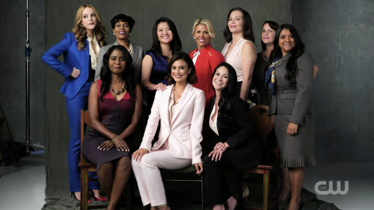 A group of women, including Fallon and Cristal, pose for a photo.