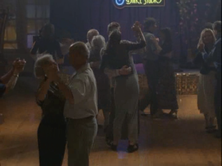 Joey stands on Pacey's feet while they dance.