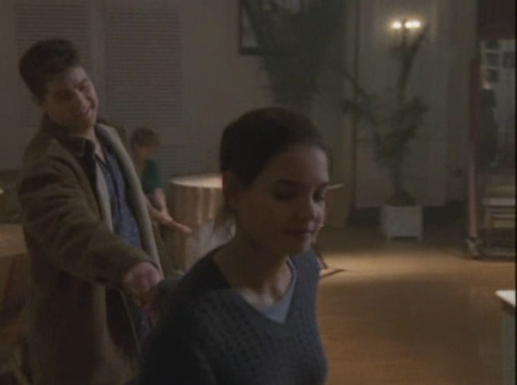 Foreground, Joey drags Pacey (background) along by the hand. Pacey smiling.