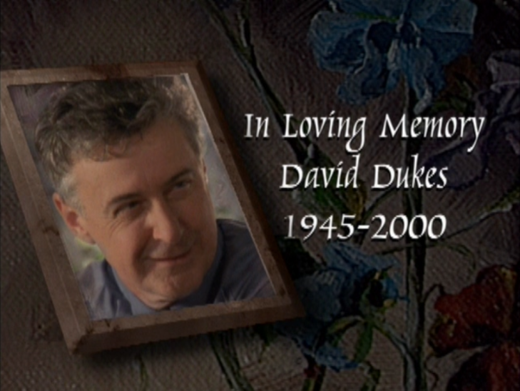 "Shot of Andie and Jack's dad photoshopped into a picture frame. Caption: ""In loving memory David Dukes 1945-2000"""