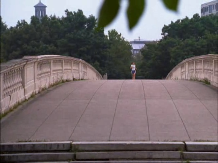 Shot of a bridge with Joey running alone down the middle of it.