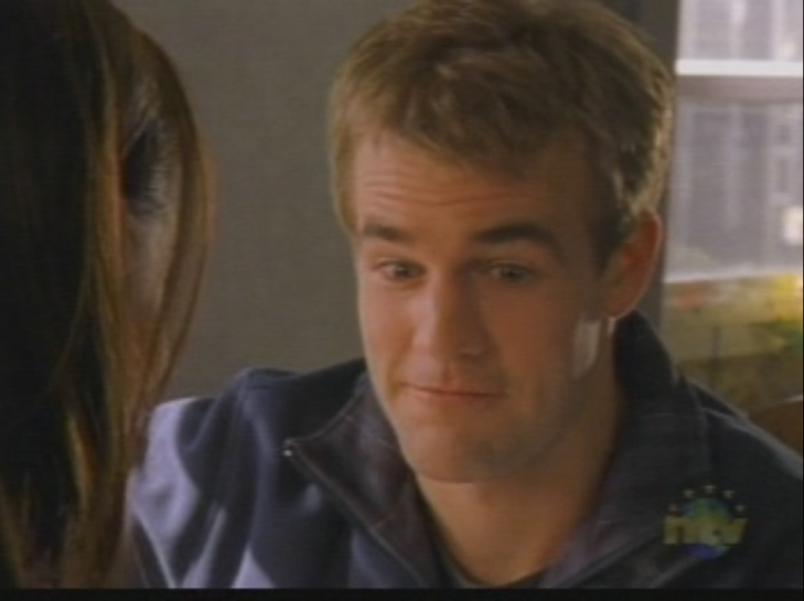 "Dawson makes a ""Well this is awkward"" face, his eyebrows raised. The edge of a woman's head (Natasha) is seen on the left."