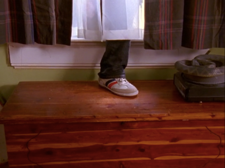 Shot of a foot (Joey's) emerging from the window that leads into Dawson's bedroom. Foot is clad in a