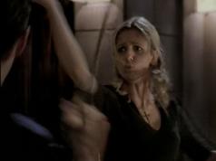 Buffy fights Angel, lips pursed