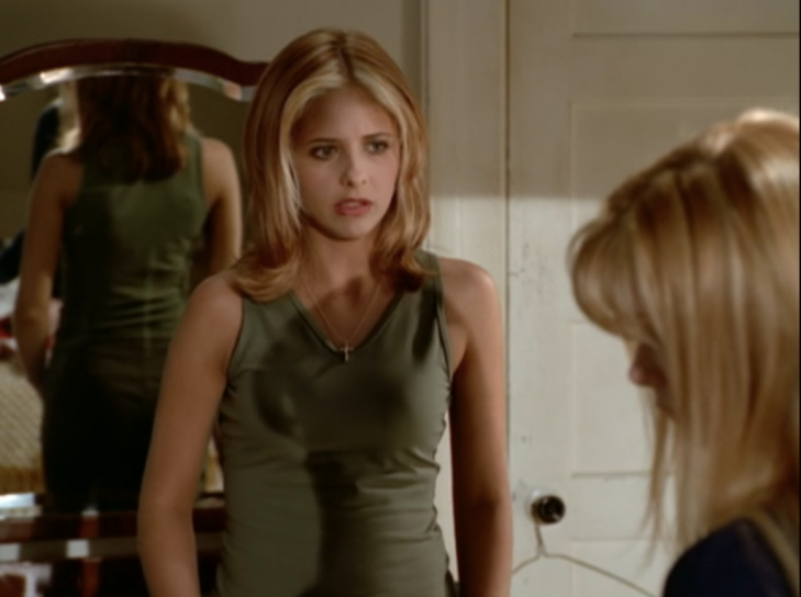 Buffy has reddish hair with blond highlights just at the front, cut in flippy shoulder-length layers.