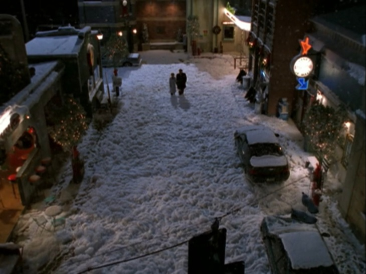 "Buffy and Angel walking through ""snow"" that looks like a foot of cotton candy."