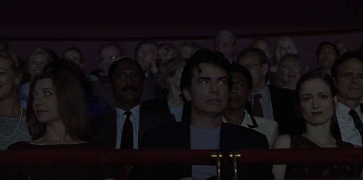 Image description: Jonathan and Kathleen in the audience, making annoyed faces